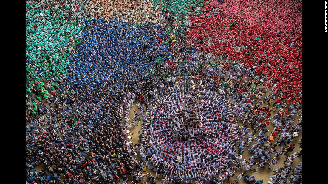 People form a human tower Sunday, October 2, during the annual Tarragona Competition in Tarragona, Spain.