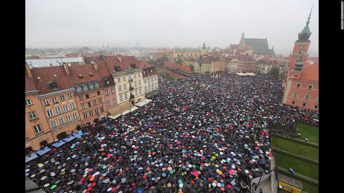 "People carry umbrellas in Warsaw, Poland, as they protest a proposed abortion ban on Monday, October 3. Poland's parliament <a href=""http://www.cnn.com/2016/10/06/europe/poland-abortion-ban-rejected/"" target=""_blank"">withdrew the legislation</a> several days later."
