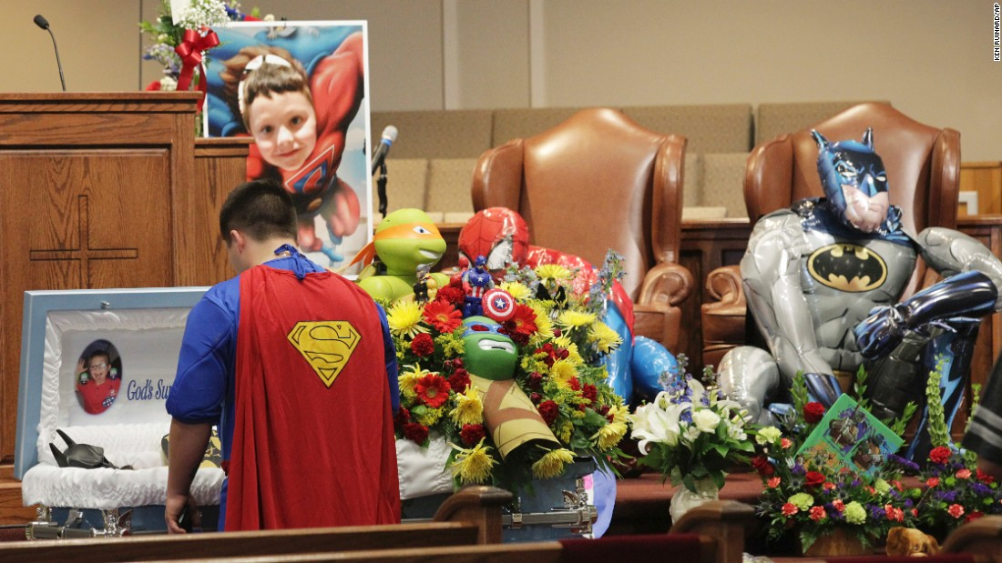 "Dale Hall, dressed as Superman, stands near the casket of his brother Jacob during his funeral in Townville, South Carolina, on Wednesday, October 5. Jacob, 6, was fatally wounded during a shooting last week at an elementary school playground. He loved superheroes, so <a href=""http://www.cnn.com/2016/10/05/us/jacob-hall-superhero-funeral-townville-south-carolina-school-shooting/"" target=""_blank"">his funeral</a> carried that theme. Funeral attendees were encouraged to wear superhero outfits, and Jacob himself was dressed as Batman."