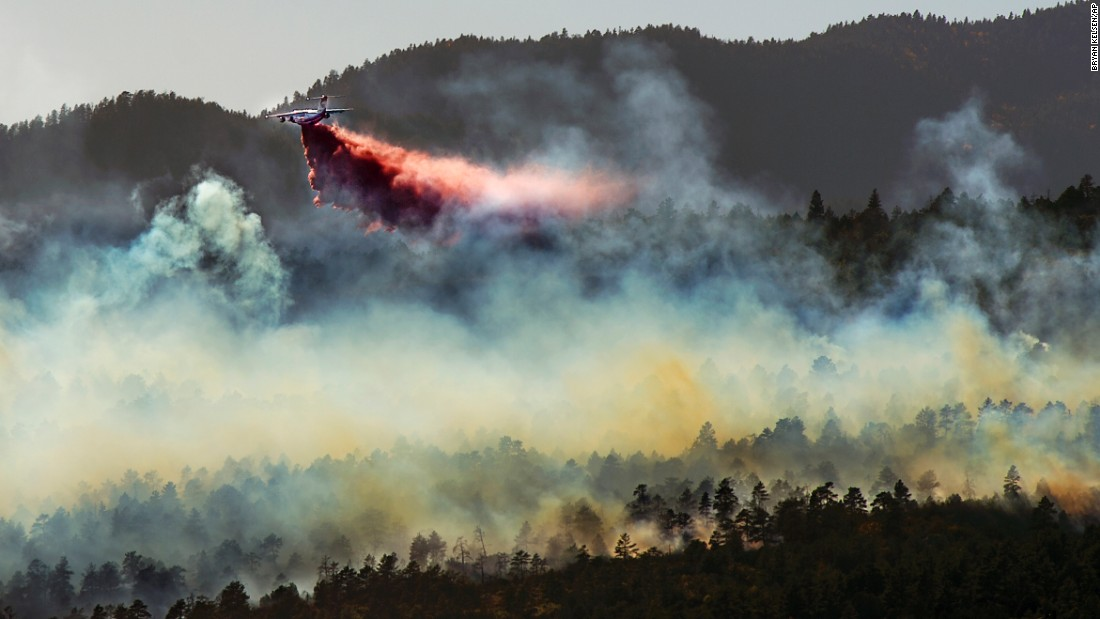 A plane drops fire retardant on a wildfire east of Beulah, Colorado, on Tuesday, October 4.