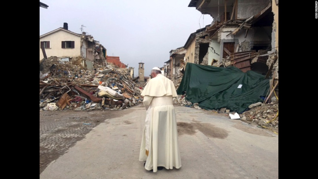 "Pope Frances prays in Amatrice, Italy, on Tuesday, October 4. The town was <a href=""http://www.cnn.com/2016/08/24/europe/italy-earthquake-towns/"" target=""_blank"">devastated by an earthquake</a> in August."