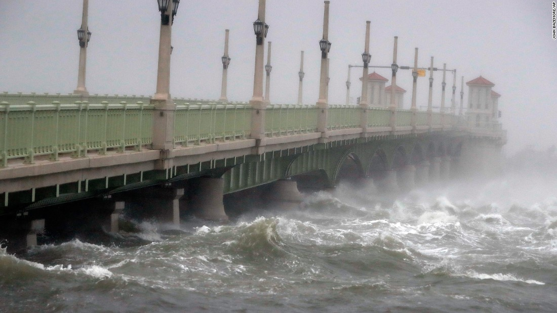 Waves crash against a bridge in St. Augustine, Florida.
