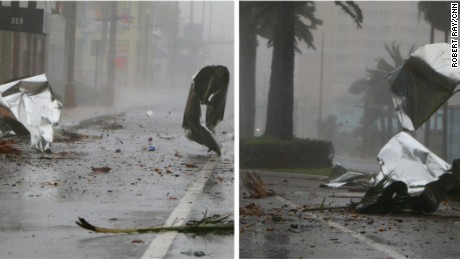 Debris flies through the streets of Daytona Beach.