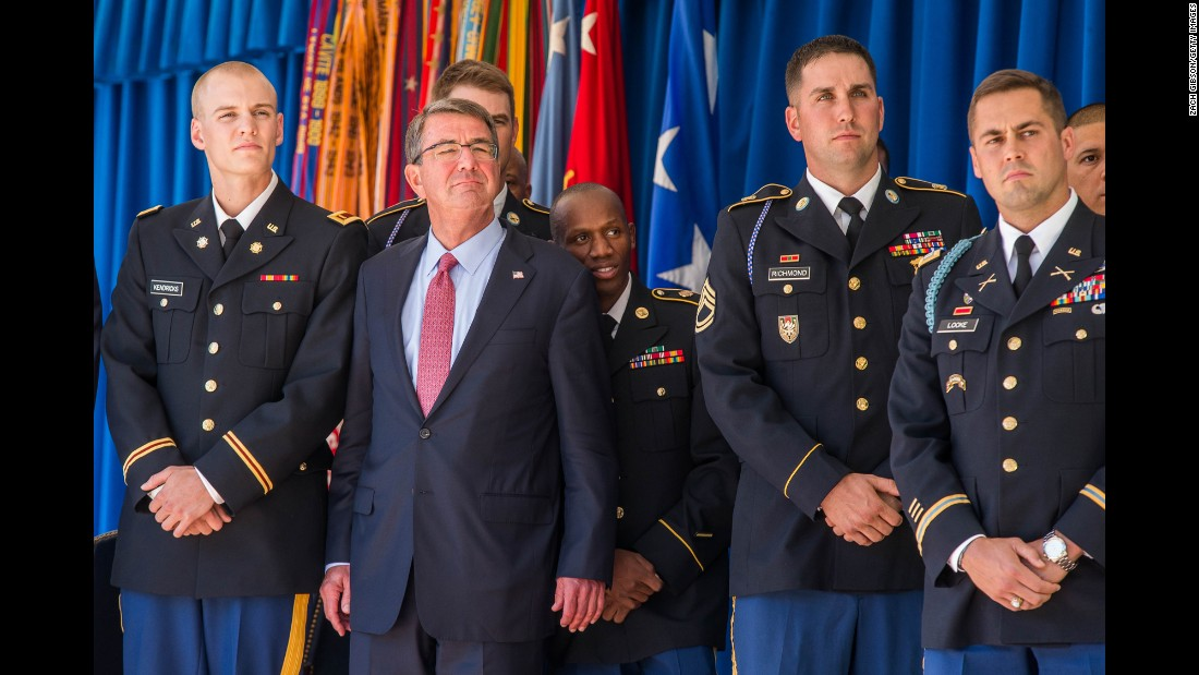 During a ceremony at the Pentagon on Monday, October 3, US Defense Secretary Ash Carter stands with members of the military who competed at the 2016 Olympics in Rio de Janeiro.