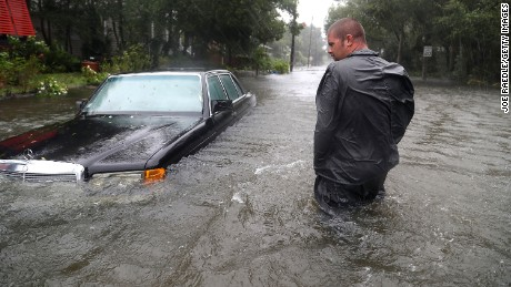 Nick Lomasney walks on a flooded street in St Augustine, Florida.