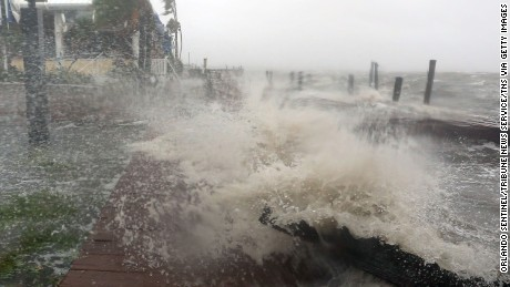 Surf from the Banana River crashes up on a dock at Sunset Grill Thursday, Oct. 7, 2016  in Cocoa Beach as the Category 4 Hurricane Matthew hit Florida's east coast. (Red Huber/Orlando Sentinel/TNS via Getty Images)
