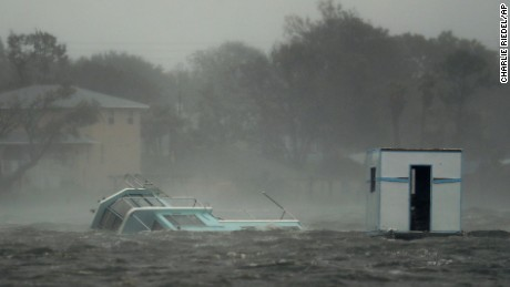 A boat is partially submerged in the Halifax River as Hurricane Matthew moves through Daytona Beach, Florida, Friday, October 7.