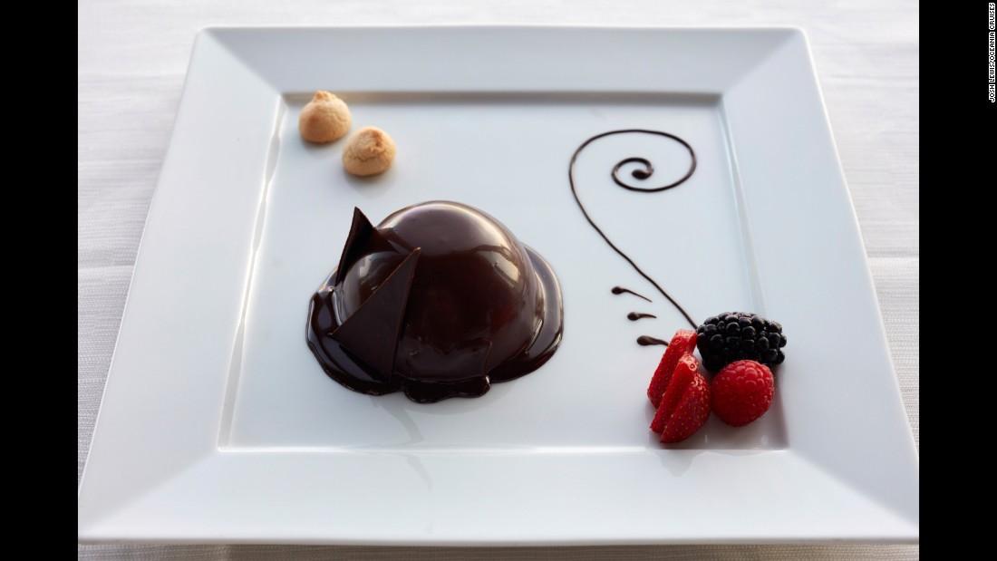 With desserts like this semifreddo di zabaione con crema al cioccolato e rum, it's no wonder that Oceania Cruises won for best luxury dining.