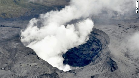 Japan's Mount Aso volcano sends a plume of ash into the air.
