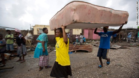 Residents rush to nearby shelters in the aftermath of Hurricane Matthew in Les Cayes, Haiti.