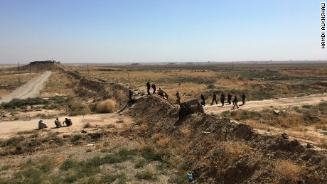 The Kurdish front line near Daqouq, Iraq. Every day dozens of people fleeing ISIS-controlled territory brave bombs and booby-traps to get here. In the last month, nine have been killed trying to reach Daqouq.