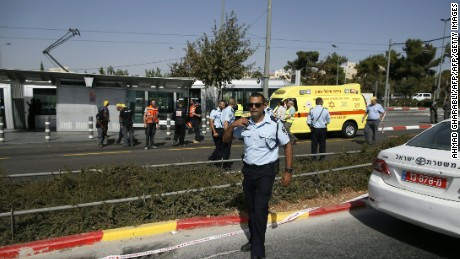 Israeli security forces and policemen gather at the site of a shooting attack near Israeli police headquarters, close to the line dividing mainly Palestinian east Jerusalem from the mostly Jewish western sector of the city, on October 9, 2016. A Palestinian opened fire from a car in Jerusalem, wounding four people out of which two have died, police shot him dead, authorities said. / AFP / AHMAD GHARABLI        (Photo credit should read AHMAD GHARABLI/AFP/Getty Images)