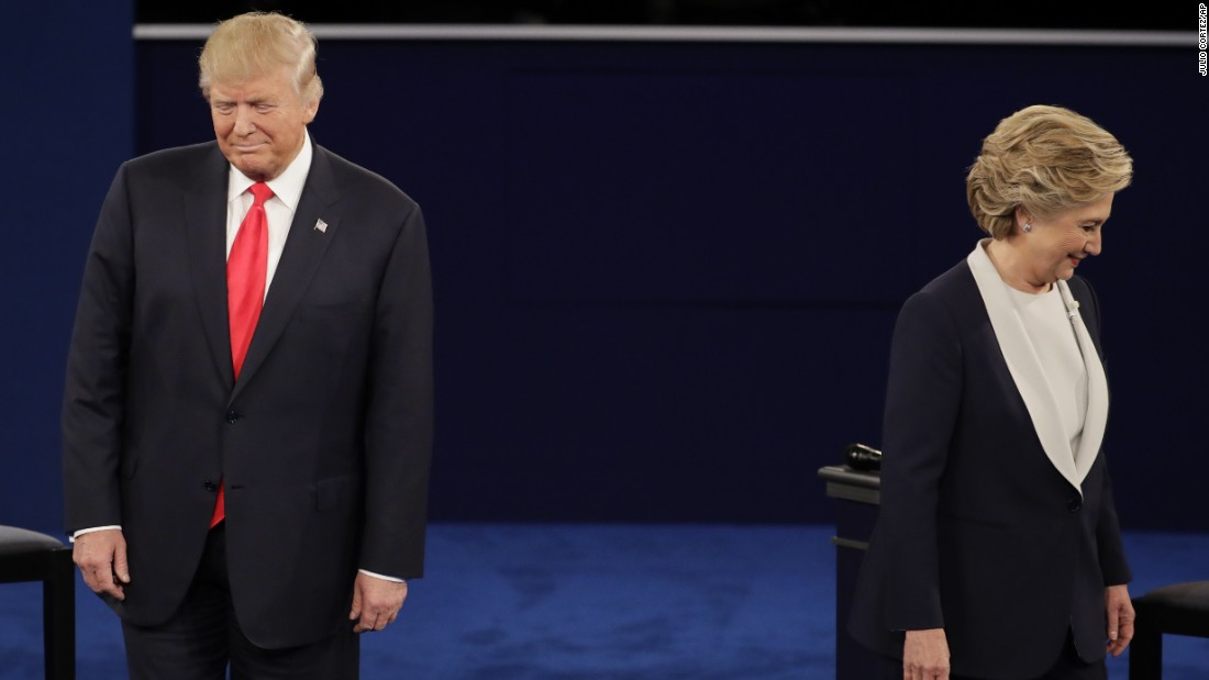 The two candidates walk to their positions at the start of the debate.