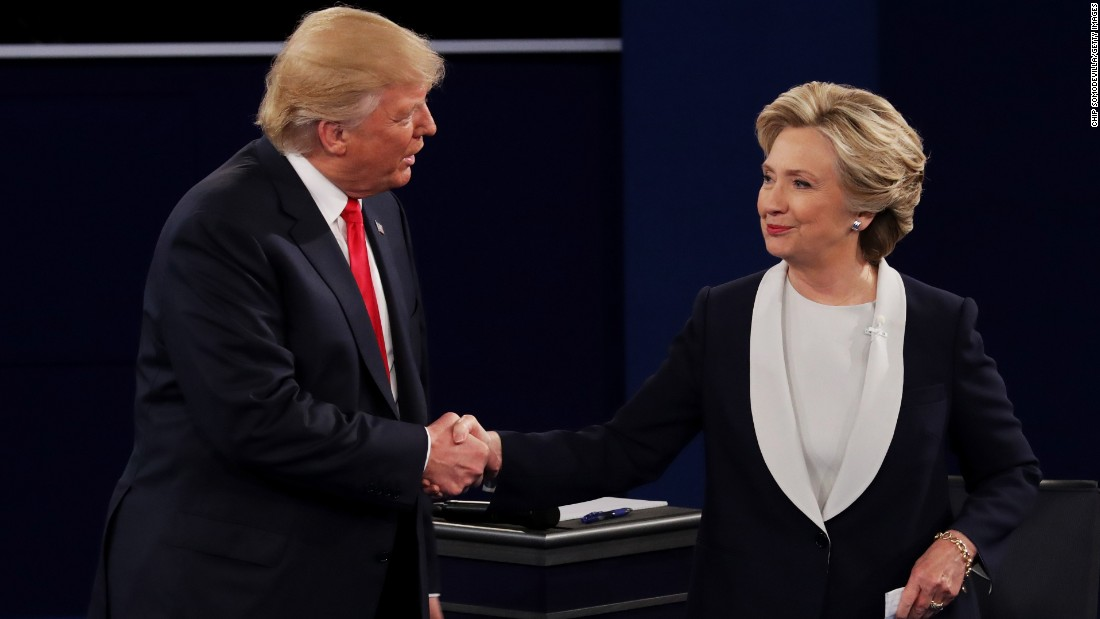 The two candidates shake hands at the end of the debate. They did not shake at the beginning.