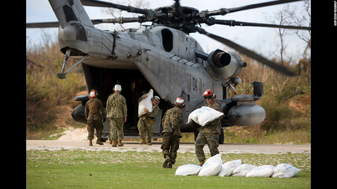 US soldiers unload bags of food from a helicopter in the hard-hit coastal city of Jeremie on October 9.