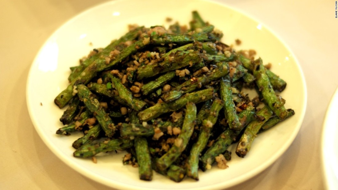 Dry-fried green beans, a signature dish often made with Sichuan peppercorns, garlic, ginger, scallions, mustard root and ground pork, has a delightful burst of flavors.