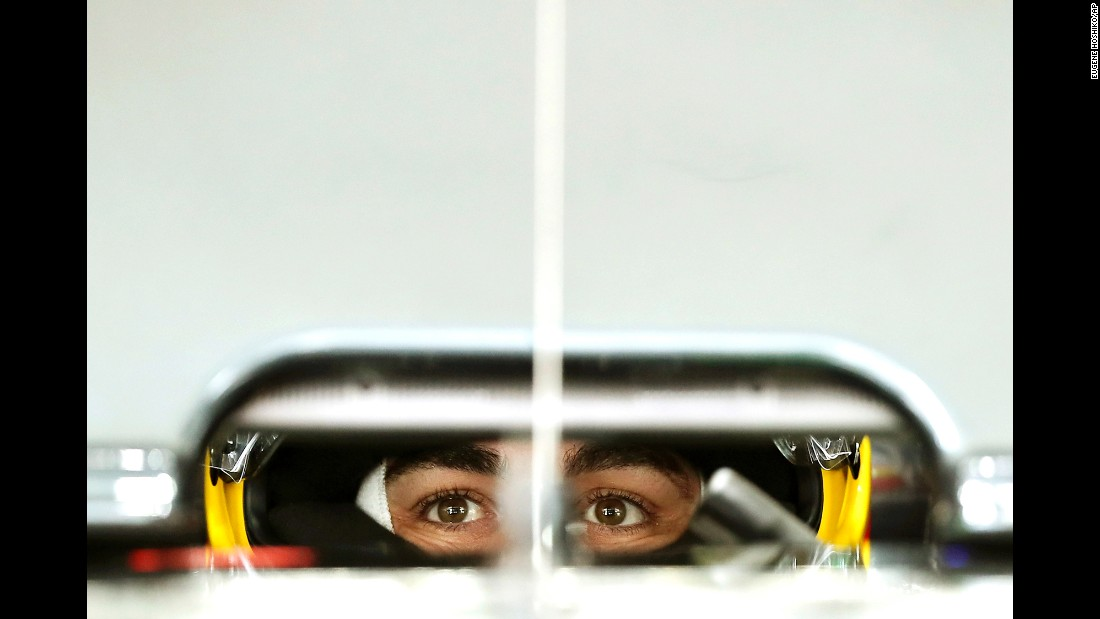 Formula One driver Fernando Alonso waits in his car during a practice session at the Japanese Grand Prix on Saturday, October 8.