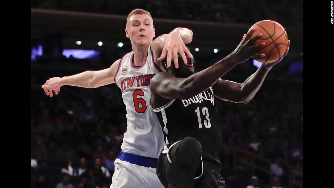 Brooklyn's Anthony Bennett is fouled by New York's Kristaps Porzingis during an NBA preseason game on Saturday, October 8.