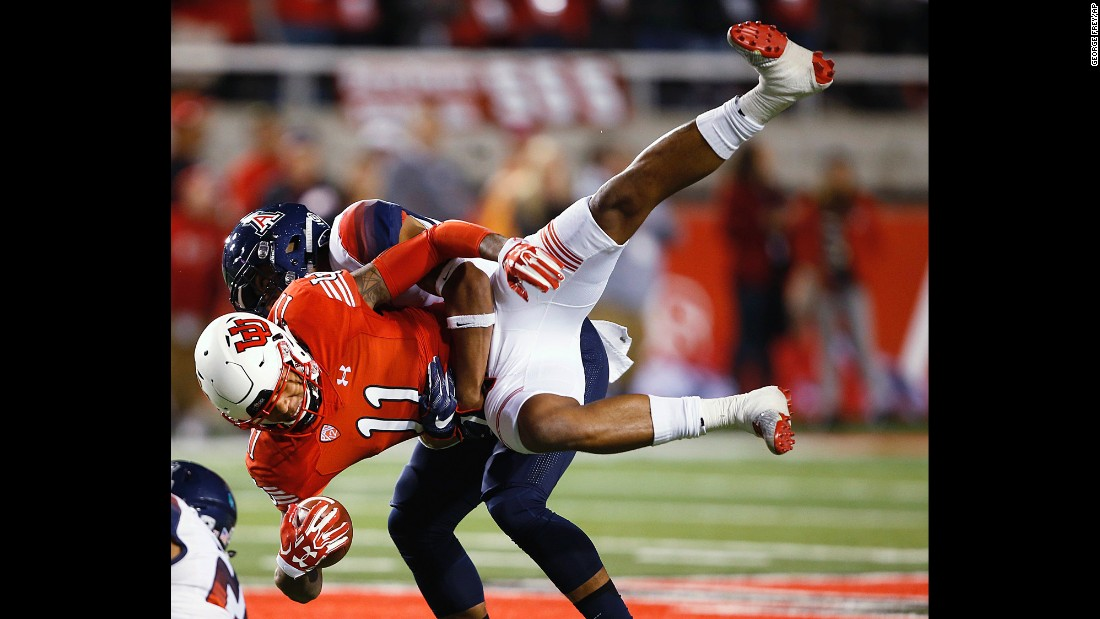Utah wide receiver Raelon Singleton is tackled by Arizona's Dane Cruikshank during a college football game in Salt Lake City on Saturday, October 8.