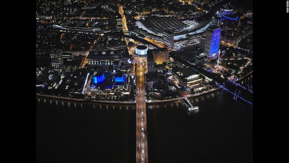 """You lean out, vertically shoot down, and that gets this unique angle,"" Lieber tells CNN. This shot captures Waterloo Bridge as it leads up to the BFI IMAX cinema. Festival Pier is on the right."