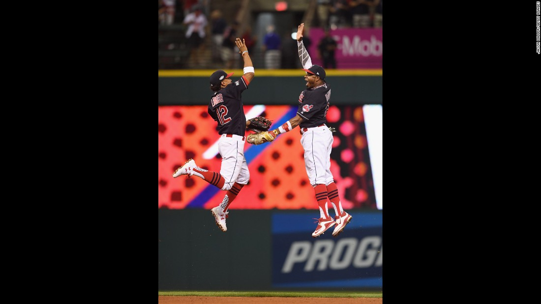 Francisco Lindor, left, and Rajai Davis celebrate after Cleveland defeated Boston in Game 2 of the American League Division Series on Friday, October 7.