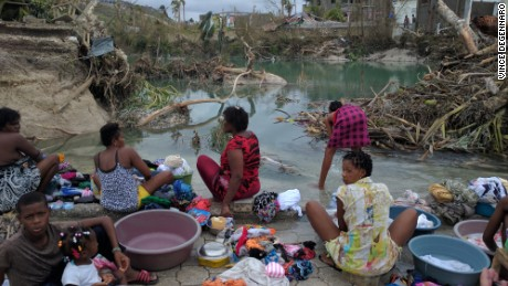 Women and children wash clothes in the aftermath of the devastating hurricane.