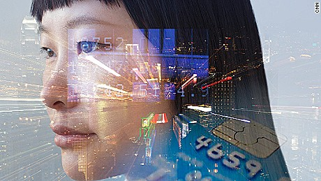 composite image of woman's face and night view of Hong Kong