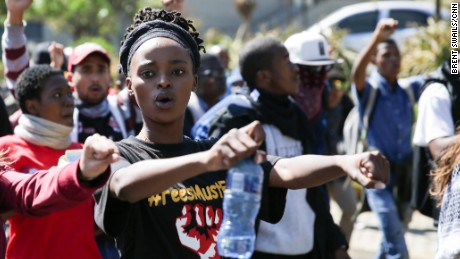 Student leader Busisiwe Seabe marches during Monday's protest. She says students feel abandoned by the government and the University of Witwatersrand.
