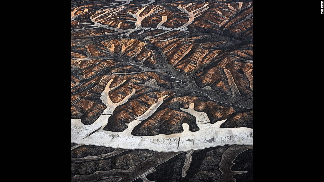"This ""Earth Patterns"" photograph was shot from a small plane and shows dryland farming in Spain."