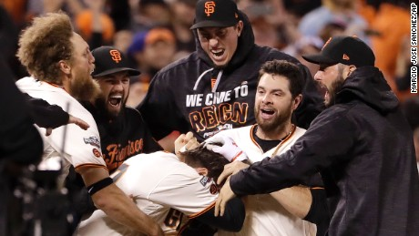 The San Francisco Giants celebrate an extra-inning win against the Chicago Cubs in Game 3 of the NDLS Monday.