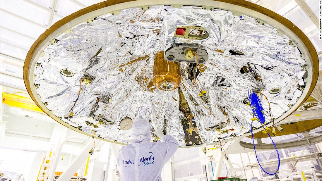 A worker from Thales Alenia Space, the company that built the ExoMars spacecraft, pictured underneath Schiaparelli in Cannes, France.