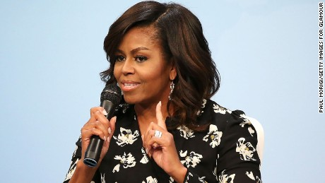 "First Lady of the United States Michelle Obama speaks during a panel discussion at Glamour Hosts ""A Brighter Future: A Global Conversation on Girls' Education"" with First Lady Michelle Obama at The Newseum on October 11, 2016 in Washington, DC."