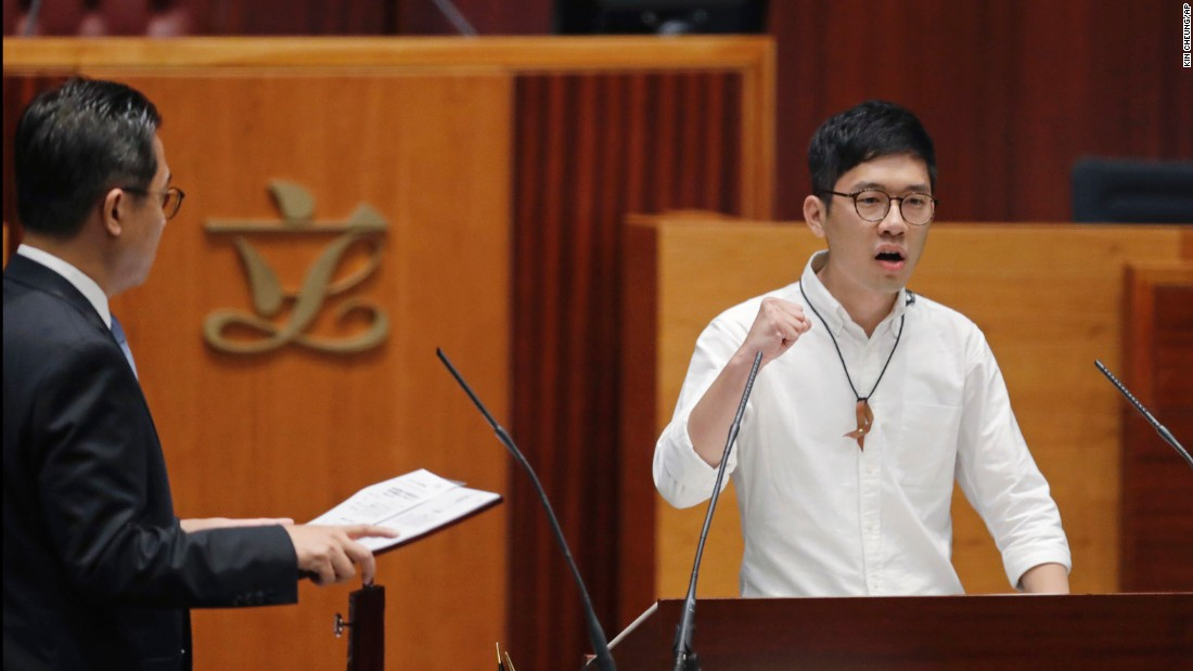 Nathan Law, the city's youngest lawmaker, quoted Ghandi before making his oath. He also refused to leave the podium demanding that the Legislative Council secretary general, Kenneth Chen, explain his reasons for refusing to accept the oaths of his fellow lawmakers.