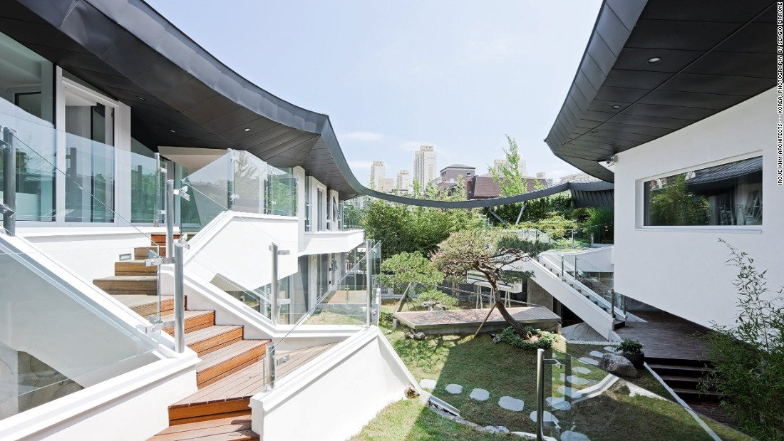 "The owners of this home in Gyeonggi Province wanted security and privacy while maintaining their access to nature. To achieve this, the architects used a traditional cantilevered Korean roof and a modern interpretation of a ""madang"" or inner court."