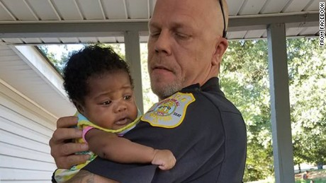 Officer Kenneth Knox  and  goddaughter Ma'Yavi Parham