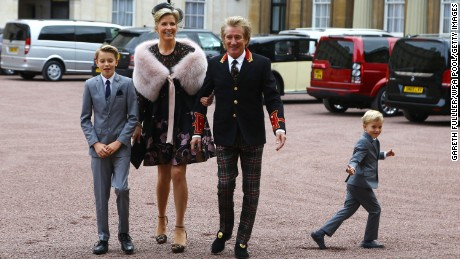 Rod Stewart arrives at Buckingham Palace with his wife, Penny Lancaster and their two children on Tuesday, October 11.