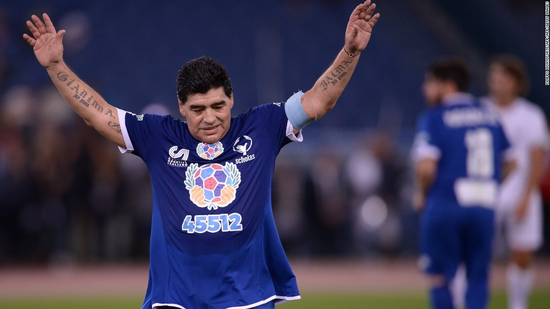 Maradona salutes the crowd as he leaves the pitch.