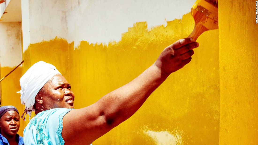 "Bishop Rose Mungafu jumped at the chance to paint her church yellow. ""For me, yellow is the color of the sun and the sun shines above everybody,"" she said."