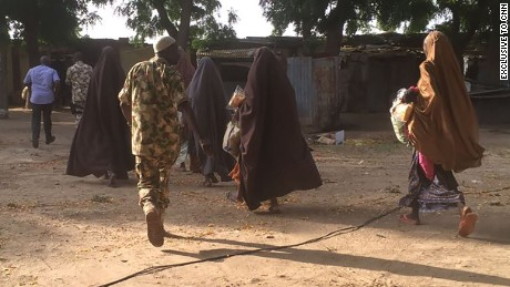 This photo, obtained exclusively by CNN, shows some of the 21 girls who were released to the Nigerian military Thursday morning in Nigeria.