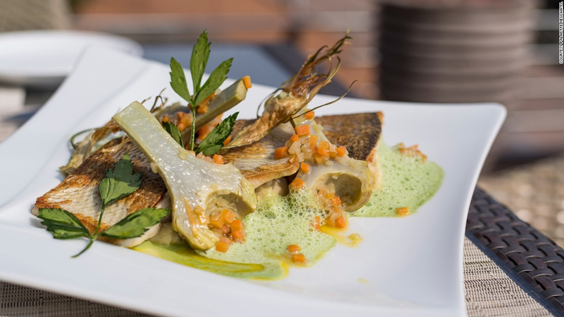 "Overlooking a lake, La Table de Palafitte in Neuchatel resembles the deck of a cruise ship. Chef David Sauvignet showcases regional products like broad whitefish or ""fera"" caught straight from the lake."