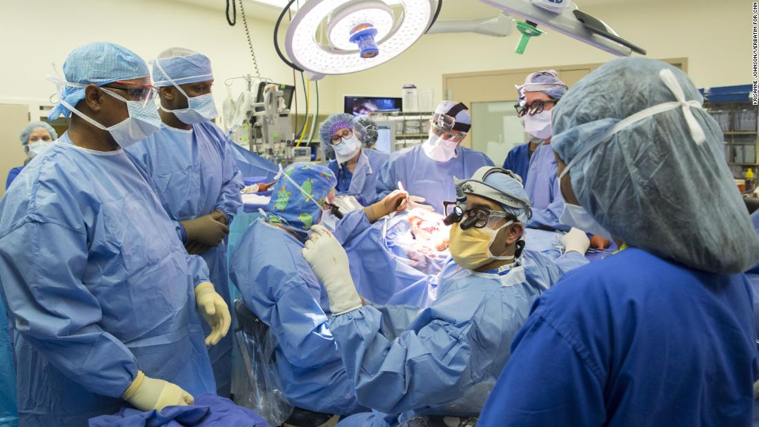 Goodrich, seated center left, leads a surgical team as they prepare to separate the then conjoined 13-month-old twins Jadon and Anias.