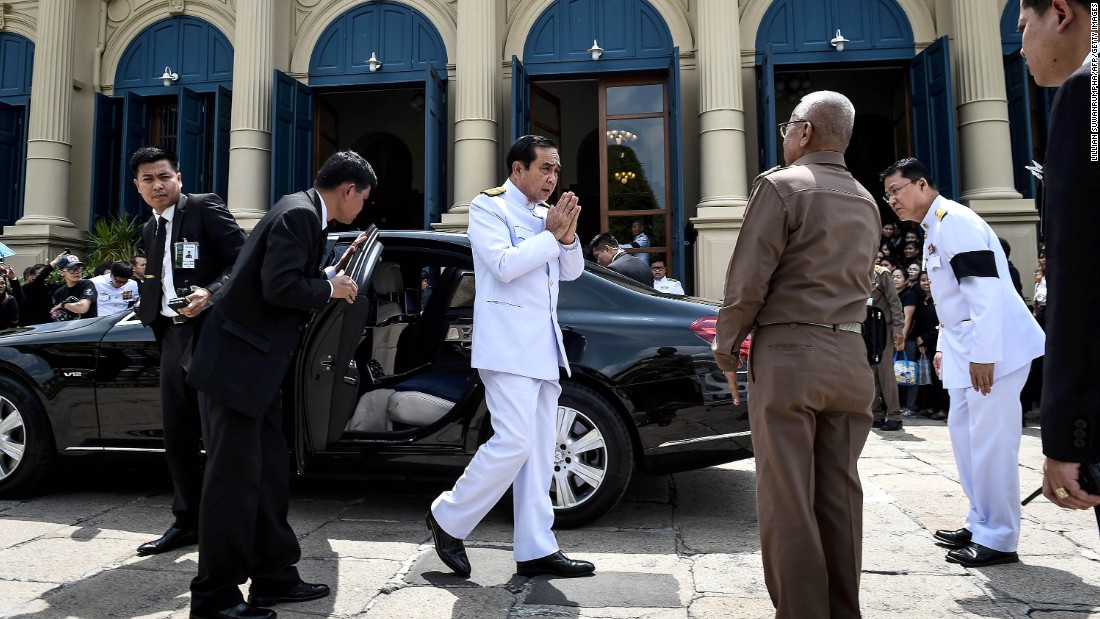 The Prime Minister arrives to pay respects to the late King at the Grand Palace on October 14.