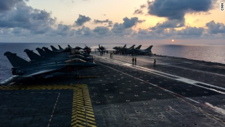 """""""President Francois Hollande has been very clear -- he wants to intensify French efforts in favor of the coalition at this key moment,"""" said the ship's admiral, Olivier Lebas."""