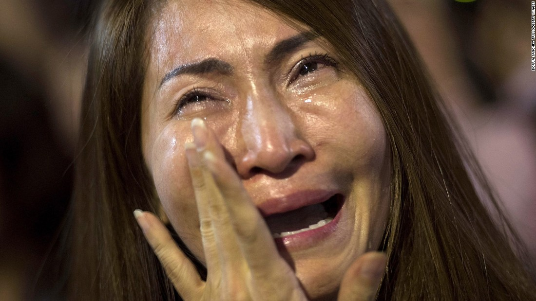 A women cries after learning of the King's death on October 13 in Bangkok.