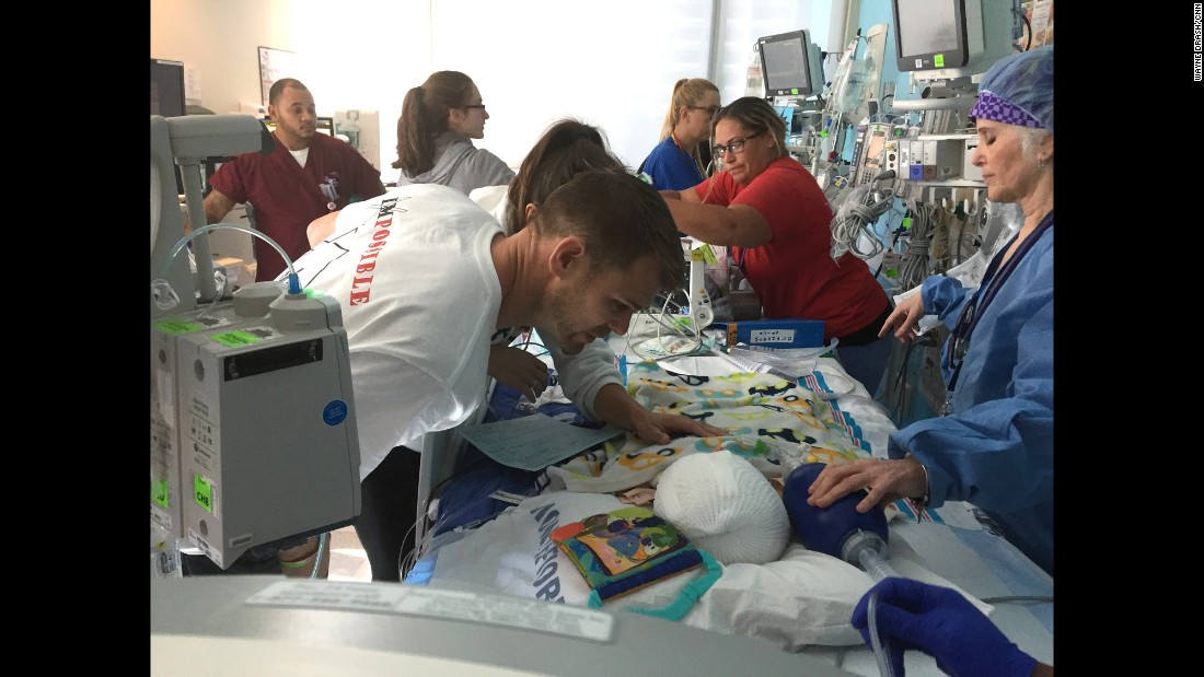 Christian gets a closer look at his son Anias, as medical staff continue to monitor the twins' conditions.