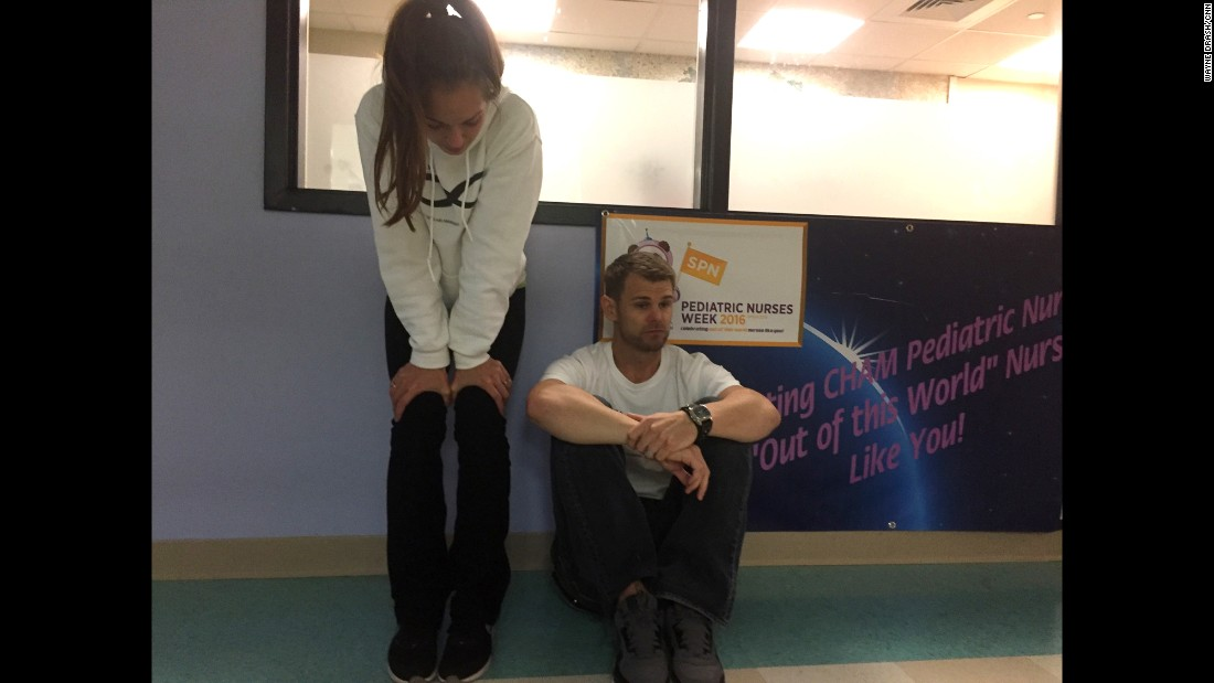 Nicole and Christian McDonald wait in the hallway for surgeons to finish operating on Anias.