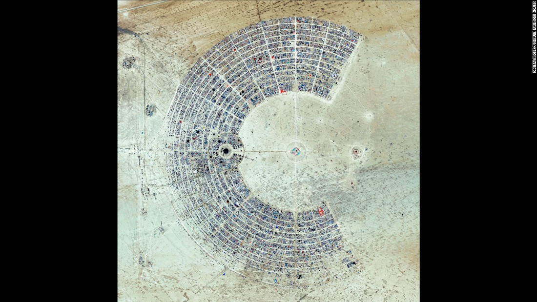 "A satellite view of Burning Man, an annual event held in the Black Rock Desert of Nevada. The gathering is described as an experiment in community, art, self-expression and radical self-reliance. One of its key principles is ""Leave No Trace,"" as significant efforts are taken to make sure the desert returns to its original state in the days following the festival."