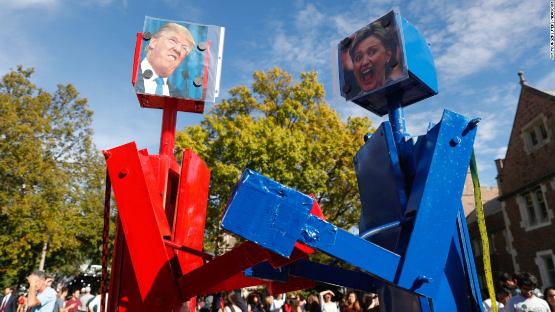 Robots with portraits of presidential nominees Donald Trump and Hillary Clinton are seen before the second presidential debate in St. Louis, Missouri, on Sunday, October 9.