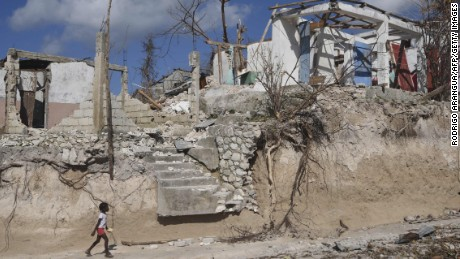 A girl walks by damage from Hurricane Matthew in Port Salut, Haiti, last week.