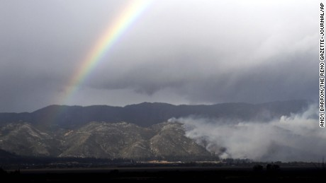 A rainbow arches over the Little Valley Fire on Friday in Washoe Lake, Nevada.